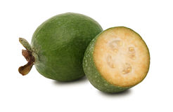 One whole and a half feijoa (isolated) Royalty Free Stock Image