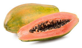 One whole and a half of papaya isolated on the white background royalty free stock photography