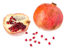 One whole and a half pomegranates with seeds. One whole and a half pomegranates with seeds isolated on white background Royalty Free Stock Photography