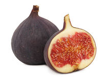 One whole and a half ripe figs (isolated) Royalty Free Stock Photography