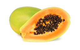 One whole and a half ripe papaya (isolated) Royalty Free Stock Images