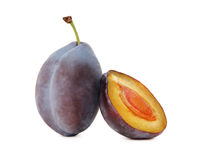 One whole and a half ripe plum (isolated) Stock Photography