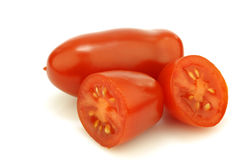 One whole italian tomato and two halves stock image