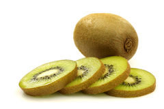 One whole kiwi and some slices. On a white background royalty free stock image