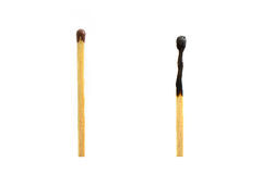 one whole and one burned match Royalty Free Stock Photos