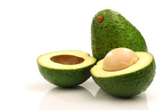 One whole and one cut avocado Stock Photo