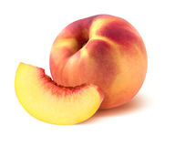 One whole peach and quarter piece  on white background Stock Photos