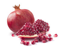 One whole pomegranate and piece on white background royalty free stock photography