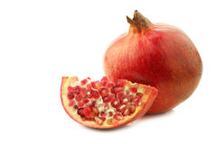 One whole pomegranate & x28;Punica granatum& x29; and a cut piece Royalty Free Stock Photo