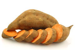 One whole sweet potato and a cut one Royalty Free Stock Photo