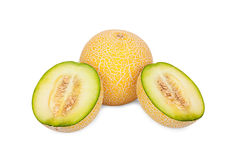 One whole and two half Galia Melons Stock Photography