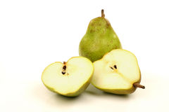 One whole and two pear halves Stock Photos