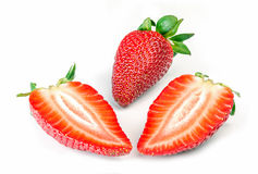 One whole and two sliced strawberries Royalty Free Stock Image