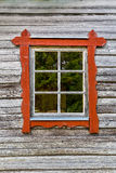 One window with red frames on log house wall, traditional style. Royalty Free Stock Photo
