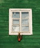 One window in vintage style in green wall background,architecture details. Colorful window fragment.Street scene with the house wi Stock Image