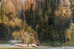 One woman bathing ma'in hot springs waterfall Jordan Stock Photo
