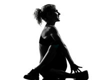 Woman warming up yoga stretching rotation fitness posture Royalty Free Stock Image