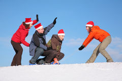 One woman pull two men on sled Royalty Free Stock Photo