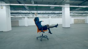 One woman riding a chair on wheels, cheerful office worker. 4K stock video