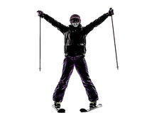One woman skier skiing arms outstretched happy silhouette Royalty Free Stock Images