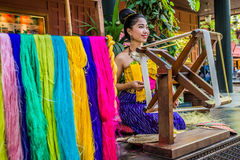 One woman spinning silk Jim Thompson House museum bangkok thaila Stock Photos