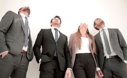 One woman three men in business suits standing in a row stock photo