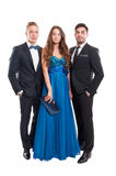 One woman and two men, all dressed elegant Stock Photo