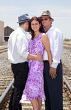 One woman and two men embracing Royalty Free Stock Photo