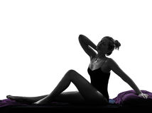 Woman waking up stretching neckache in bed silhouette Royalty Free Stock Photos
