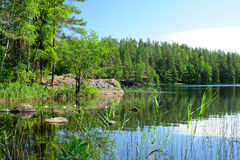 One of the wonderful lakes in Finland. Hidden in the forest Stock Photo