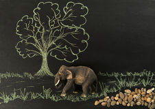 One wooden elephant walk along the forest Stock Photo