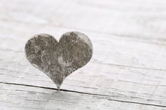 One wooden heart on a background for a greeting card. Stock Image