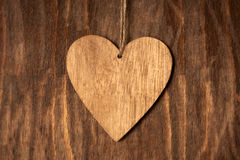 One Wooden Heart With Rope On Wooden Background Stock Images