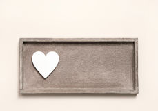 One wooden heart on a sign for a greeting card. Royalty Free Stock Image