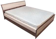 One wooden king size bedstead  with  innerspring mattress, on wh Stock Images