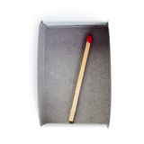 One Wooden match in box  isolated over the white background Royalty Free Stock Image