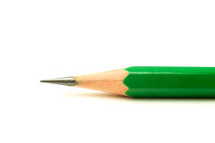 One wooden pencil green on over white royalty free stock images