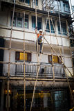 One worker building a bamboo scaffolding in hong kong, china Royalty Free Stock Images