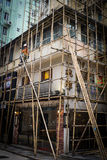 One worker building a bamboo scaffolding in hong kong, china Stock Images