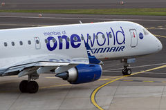 One World on Finnair plane. One World is one of the mair airlines alliance, here seen on a Finnair plane special paint scheme. Other members include: Bristish Royalty Free Stock Photos