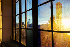 Lower Manhattan Skyline Afternoon Window. One World Trade Center (aka Freedom Tower) and Lower Manhattan skyline seen through defocused window back lit by Royalty Free Stock Photography