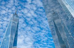 One World Trade Center or Freedom Tower, reflection of cloudy blue sky, New York. USA