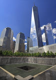 One World Trade Center reflected and memorial fountain, New York, USA Stock Images