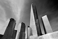 One World Trade Center skyscraper surrounded by glass buildings, New York Stock Photos