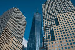 One World Trade Center tower in lower Manhattan against clear blue sky in New York City royalty free stock image