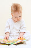 One year baby boy reads children's book Royalty Free Stock Photos