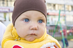 One year boy sad portrait outside Royalty Free Stock Photography