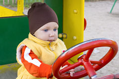 One year boy in toy car Royalty Free Stock Image