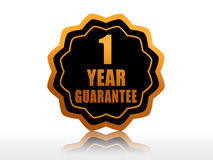One year guarantee starlike label. One year guarantee - golden starlike label with text Stock Images