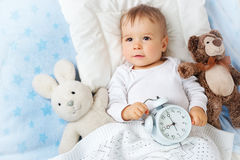 One year old baby with alarm clock Royalty Free Stock Photography